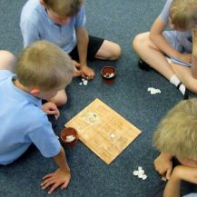 Children playing history games in classroom workshop